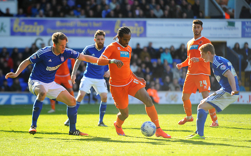 Blackpool's Nathan Delfouneso under pressure from Ipswich Town's Christophe Berra<br /> <br /> Photographer Kevin Barnes/CameraSport<br /> <br /> Football - The Football League Sky Bet Championship - Ipswich Town v  Blackpool - Saturday 11th April 2015 - Portman Road - Ipswich<br /> <br /> &copy; CameraSport - 43 Linden Ave. Countesthorpe. Leicester. England. LE8 5PG - Tel: +44 (0) 116 277 4147 - admin@camerasport.com - www.camerasport.com