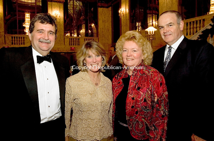WATERBURY, CT -31 DECEMBER 2005 -123105J10---Event Chairperson Carl Cicchetti, left, and his wife Carolyn, with Cathy Brunnock and her husband Probate Judge Tom Brunnock during the Palace Theater second annual pre-season gala prior to the Earth, Wind and Fire concert on Friday evening. 225 people attended the fund-raising gala which will benefit the Palace Theater, now in it's second season after it's historic rennovation. Both the gala and the concert were sponsored by Webster Bank.-- Jim Shannon Republican American- Carl Cicchetti; Carolyn Cicchetti; Cathy Brunnock; Tom Brunnock; Earth; Wind and Fire; Palace Theater, Webster Bank are CQ NOTE THIS PHOTO RAN AS A DAILY PHOTO ON NEW YEARS DAY-JS