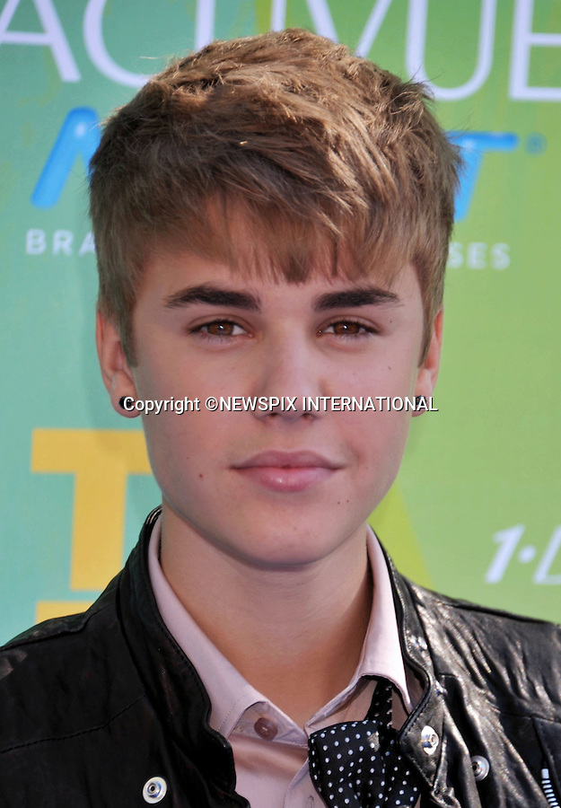 """JUSTIN BIEBER.attends the Teen Choice 2011 at the Gibson Amphitheatre, Universal City, California_07/08/2011.Mandatory Photo Credit: ©Crosby/Newspix International. .**ALL FEES PAYABLE TO: """"NEWSPIX INTERNATIONAL""""**..PHOTO CREDIT MANDATORY!!: NEWSPIX INTERNATIONAL(Failure to credit will incur a surcharge of 100% of reproduction fees).IMMEDIATE CONFIRMATION OF USAGE REQUIRED:.Newspix International, 31 Chinnery Hill, Bishop's Stortford, ENGLAND CM23 3PS.Tel:+441279 324672  ; Fax: +441279656877.Mobile:  0777568 1153.e-mail: info@newspixinternational.co.uk"""