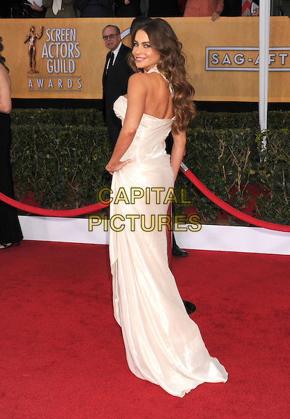 Sofia Vergara (wearing Donna Karan Atelier).Arrivals at the 19th Annual Screen Actors Guild Awards at the Shrine Auditorium in Los Angeles, California, USA..27th January 2013.SAG SAGs full length white hand on hips looking over silk satin one strap off the shoulder  .CAP/ROT/TM.©Tony Michaels/Roth Stock/Capital Pictures