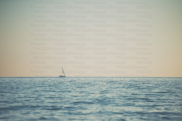 A boat out to sea off the coast of Nice, France