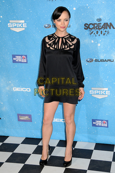 CHRISTINA RICCI.Spike TV's Scream 2009 held at the Greek Theatre, Los Angeles, California, USA..October 17th, 2009.full length black dress cut out neckline shoes pale skin sleeves long sleeved .CAP/ADM/BP.©Byron Purvis/AdMedia/Capital Pictures.