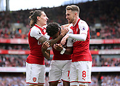 1st October 2017, Emirates Stadium, London, England; EPL Premier League Football, Arsenal versus Brighton; Alex Iwobi of Arsenal celebrates scoring his sides second goal with Hector Bellerin of Arsenal and Aaron Ramsey of Arsenal, 2-0 Arsenal