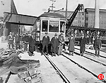 The first trolley to cross the new Washington Avenue Bridge on South Main Street led by two others in a final salute to electric passenger transportation between Waterbury and points south. Buses were the transportation of the day between Waterbury and Naugatuck. Those pictured here include: Otis Fairley,motorman; A.B. foster, roadmaster for the Connecticut Co.' Herbert Scott-Smith, bridge construction engineer; City Engineer Cairus; Charles Root, Assistant City Engineer; Patsy Capello, Connecticut Co. foreman; and C. Marrabattini, an additional foreman for the trolley company.