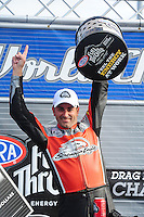 Nov. 13, 2011; Pomona, CA, USA; NHRA pro stock motorcycle rider Eddie Krawiec celebrates after clinching the 2011 championship during the Auto Club Finals at Auto Club Raceway at Pomona. Mandatory Credit: Mark J. Rebilas-.