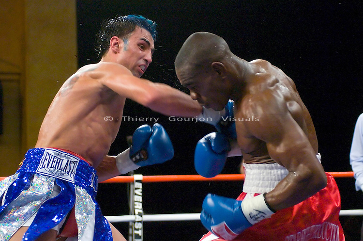 Paulie Malignaggi (white/blue) on the attack against Edner Cherry during their 10 rounds lightweight fight at the Hammerstein ballroom in NYC on 02.17.07.<br />Malignaggi won by unanimous decision.