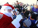 Santa greets students at the 11th annual Holiday with a Hero at Walmart in Carson City, Nev., on Wednesday, Dec. 16, 2015. <br /> Photo by Cathleen Allison