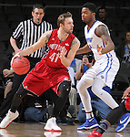 SIOUX FALLS, SD - MARCH 5:  Eric Robertson #41 of South Dakota drives past Deangelo Stewart #1 of Fort Wayne in 2016 Summit League Tournament play.  (Photo by Dick Carlson/Inertia)