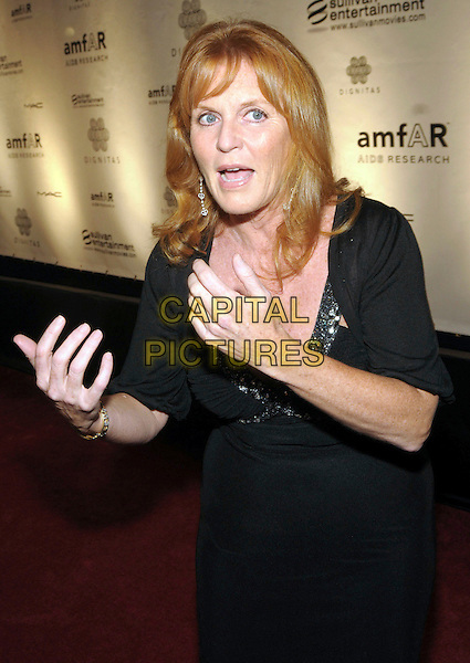 SARAH FERGUSON, DUCHESS OF YORK .Cinema Against AIDS during the 2009 Toronto International Film Festival, Toronto, Ontario, Canada, USA, .15th September 2009..half length black dress cleavage  shrug Fergie  royal beaded trim jewel encrusted embellished hands speaking gesture funny interview talking .CAP/ADM/BPC.©Brent Perniac/Admedia/Capital Pictures