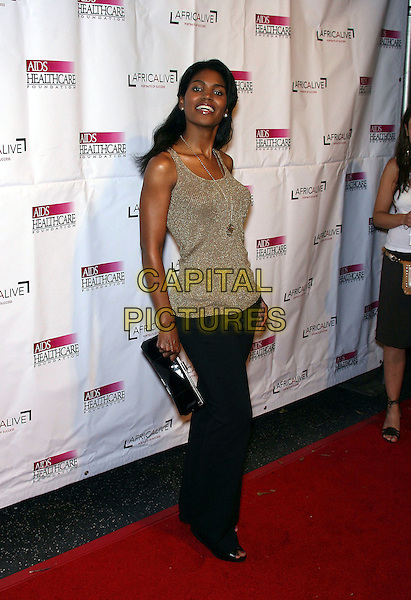 "DENISE BOUTE.The AIDS Healthcare Foundation Presents ""Hot In Hollywood"" at the Henry Fonda Theatre, Hollywood, California, USA,12 August 2006..full length funny gold necklace grey vest top.Ref: ADM/ZL.www.capitalpictures.com.sales@capitalpictures.com.©Zach Lipp/AdMedia/Capital Pictures."