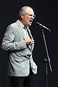 Actor Jim Broadbent performs a poem onstage at Belfast Botanic Gardens, where the Big IF Belfast concert is taking place ahead of the G8 Summit in Northern Ireland, Saturday, June 15, 2013.  Photo/Paul McErlane