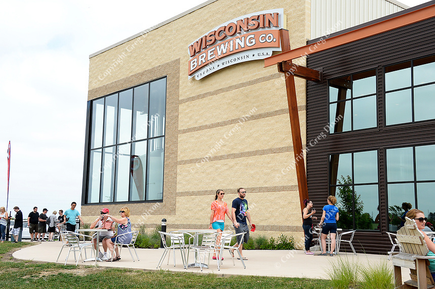People arrive at Wisconsin Brewing Company to see the creation of Depth Charge Scotch Ale on Sunday in Verona, Wisconsin