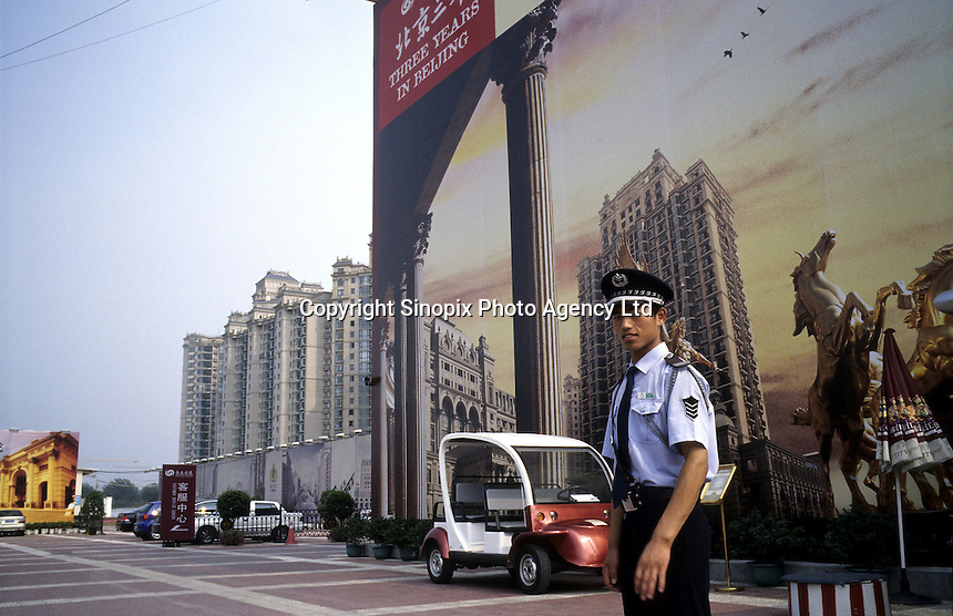 A security man guards a luxury apartment coming into the market in CBD of Beijing, China..24 Jul 2005