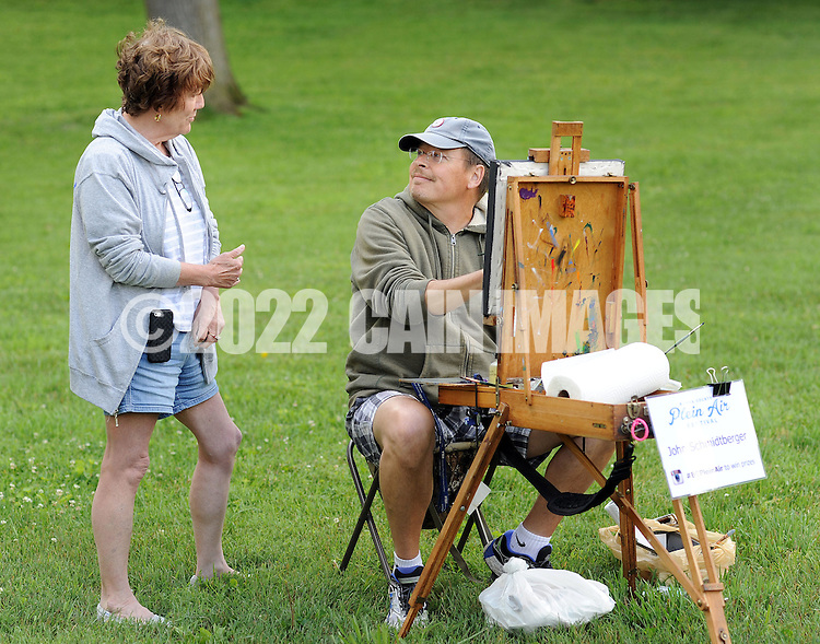 "From left, Addie Hocynec, of Lansdale, Pennsylvania and a painter herself, speaks with fellow artist John Schmidtberger as he paints a picture during the first ever Bucks County Plein Air Festival Wednesday June 8, 2016 at the Mercer Museum in Doylestown, Pennsylvania.  The competitively-selected artists will paint outdoors ""en plein air"" or ""in open air"" over the course of three days in various locations throughout the county to create various landscapes and streetscapes. (Photo by William Thomas Cain)"