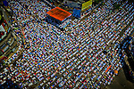 Thousands of Bangladeshi Muslim activists attend Jumma prayer on a road in Dhaka, Bangladesh.