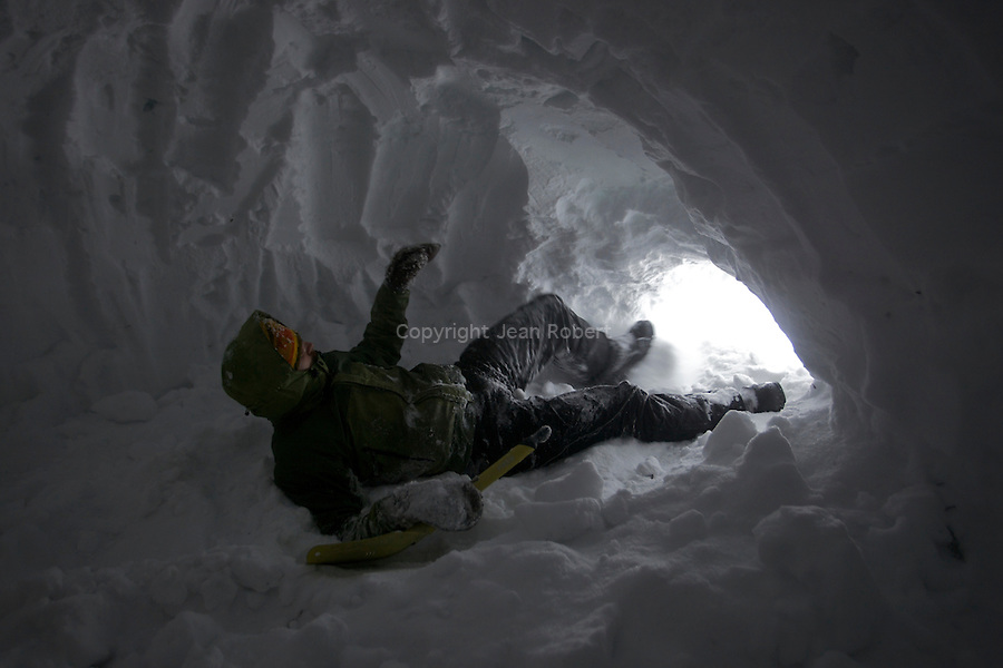 Night in a snow house (igloo) on the forests nearby Snejaia river on  the khamar Daban  mountains