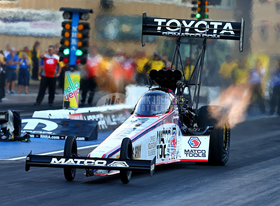 Jul. 18, 2014; Morrison, CO, USA; NHRA top fuel driver Antron Brown during qualifying for the Mile High Nationals at Bandimere Speedway. Mandatory Credit: Mark J. Rebilas-