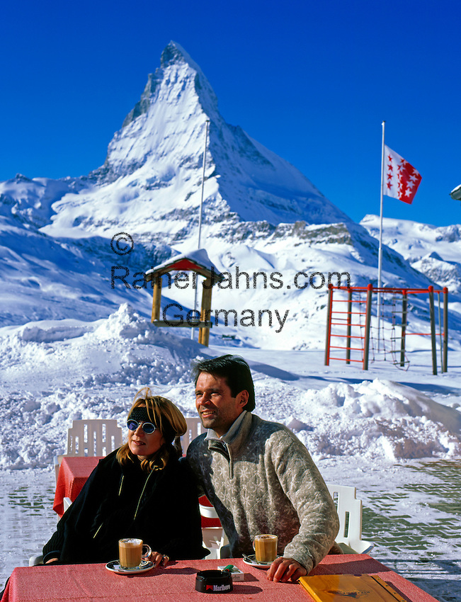 Switzerland, Valais, Zermatt, Couple at Cafe Riffelberg and Matterhorn Mountain (4.478 m)