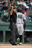 Home plate umpire Adam Clark works a game between the Augusta GreenJackets and the Greenville Drive on Thursday, August 29, 2019, at Fluor Field at the West End in Greenville, South Carolina. Augusta won, 11-0. (Tom Priddy/Four Seam Images)