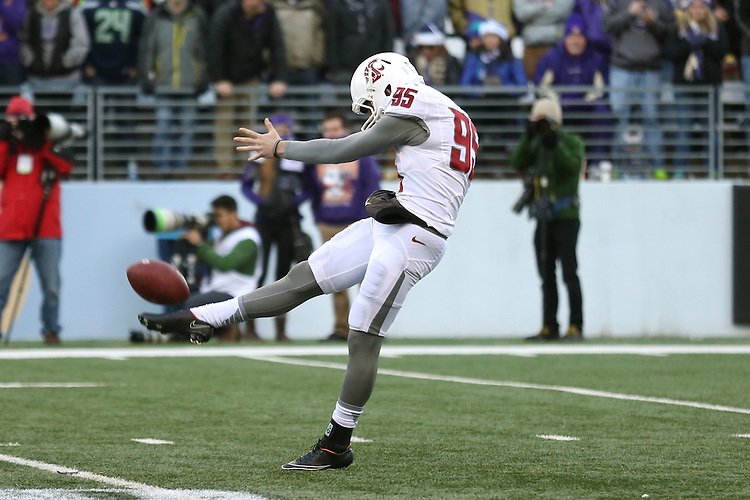 Zach Charme, Washington State University punter, connects with the ball during the Cougars Pac-12 conference road game against Washington in Seattle on November 27, 2015.