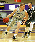 SIOUX FALLS, SD - DECEMBER 8:  Clint Thomas #34 from the University of Sioux Falls drives against Taylor Schafer #20 from Southwest Minnesota State Tuesday night at the Stewart Center. (Photo by Dave Eggen/Inertia)