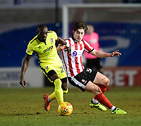 Lincoln City's Alex Woodyard vies for possession with Cheltenham Town's Sanmi Odelusi<br /> <br /> Photographer Chris Vaughan/CameraSport<br /> <br /> The EFL Sky Bet League Two - Lincoln City v Cheltenham Town - Tuesday 13th February 2018 - Sincil Bank - Lincoln<br /> <br /> World Copyright &copy; 2018 CameraSport. All rights reserved. 43 Linden Ave. Countesthorpe. Leicester. England. LE8 5PG - Tel: +44 (0) 116 277 4147 - admin@camerasport.com - www.camerasport.com