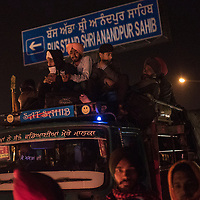 ANANDPUR SAHIB, INDIA - March 05, 2015: Indian Sikh devotees travel by road to participate in Hola Mohalla celebrations on March 05, 2015 in Anandpur Sahib, India. Hola Mahalla or simply Hola is a Sikh event, which takes place on the first of the lunar month of Chet, which usually falls in March, and sometimes coincides with the Sikh New Year. It was started by Guru Gobind Singh the tenth Sikh guru in 1701 AD. Hola Mohalla is a three day Sikh festival, in which Nihang Sikh 'warriors' perform Gatka (mock encounters with real weapons), tent pegging and bareback horse-riding, which usually falls in March coinciding with or following the Hindu festival of Holi. <br /> Daniel Berehulak for The New York Times