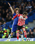 Chelsea's David Luiz tussles with Southampton's Manolo Gabbiadini during the Premier League match at Stamford Bridge Stadium, London. Picture date: April 25th, 2017. Pic credit should read: David Klein/Sportimage