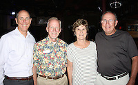 NWA Democrat-Gazette/CARIN SCHOPPMEYER Peter Lane, Walton Arts Center chief executive officer (from left), Mel Phillips, coordinator of volunteer programs, and Jacque and Mike Allen visit the arts center's volunteer appreciation night July 6 at George's Magestic Lounge in Fayetteville.