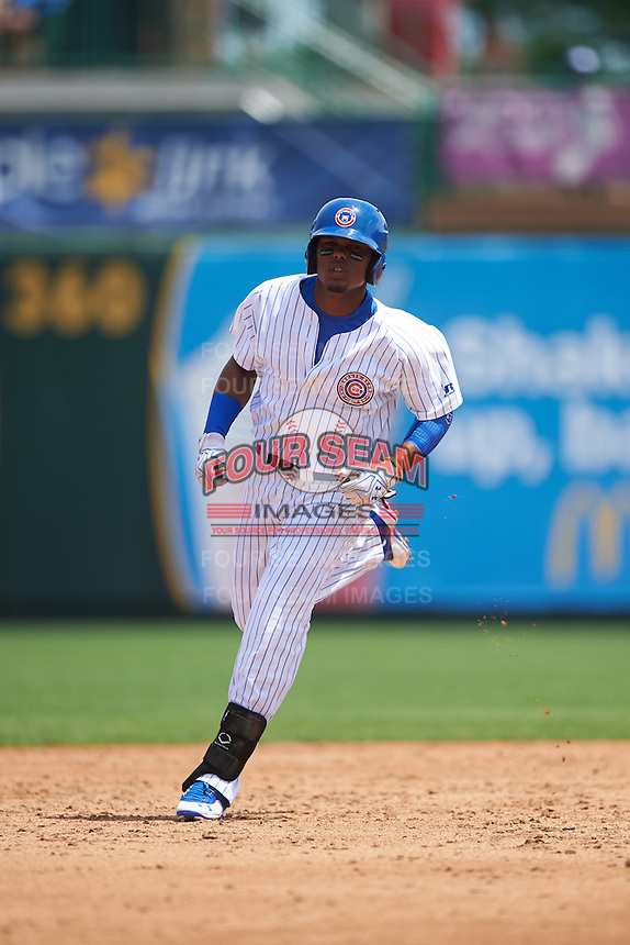 South Bend Cubs right fielder Eddy Martinez (15) running the bases during the first game of a doubleheader against the Peoria Chiefs on July 25, 2016 at Four Winds Field in South Bend, Indiana.  South Bend defeated Peoria 9-8.  (Mike Janes/Four Seam Images)