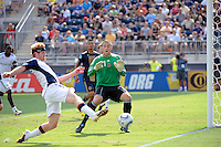 Philadelphia Union goalkeeper Chris Seitz (1) watches as Pat Phelan (28) of the New England Revolution is unable to put a shot on net. The Philadelphia Union and the New England Revolution  played to a 1-1 tie during a Major League Soccer (MLS) match at PPL Park in Chester, PA, on July 31, 2010.