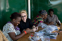 KAMPALA, UGANDA: Mary Fisher, an Aids activist, author and artist teaches women crafts during a workshop in Kampala, Uganda. Mary Fisher is infected with HIV-Aids and held a passionate speech at the Republican Convention in 1992 speaking about Aids.