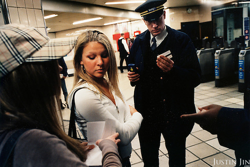 Controllers catch women riding with child's tickets in London metro. The women pleaded ignorance and were let off..Picture taken 2005 by Justin Jin