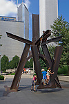 Kids playing on a metal sculpture by Mark Di Suvero Chicago's, Millenium Park