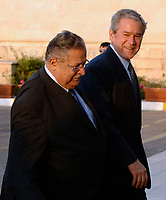 Baghdad, Iraq - December 14, 2008 -- United States President George W. Bush walks with President Jalal Talabani of Iraq on Sunday, December 14, 2008 into Salam Palace in Baghdad. Bush is on his final visit to Iraq before the end of his second presidential term to meet with Iraqi leaders and sign a ceremonial copy of the security agreement.<br /> CAP/MPI/CNP/RS<br /> &copy;RS/CNP/MPI/Capital Pictures