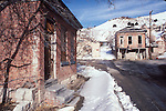 Abandoned buildings, snow, Eureka, Nevada