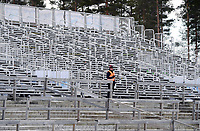 March 14th 2020, Kontiolahti, Finland;  A lone official stands at the stands during the mens 12.5 km Pursuit competition at the IBU Biathlon World Cup in Kontiolahti, Finland, on March 14, 2020. All competitions are competed without spectators due to the outbreak of the COVID-19 coronavirus.
