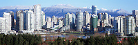 "City of Vancouver Skyline and Downtown at Yaletown District and ""False Creek"", BC, British Columbia, Canada, in Spring.  The North Shore Mountains (Coast Mountains) rise above the City. - Panoramic View"