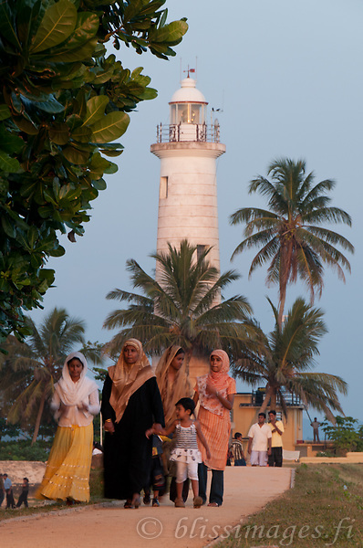 Muslim women stroll at Galle Fortress Lighthouse in Southern Sri Lanka