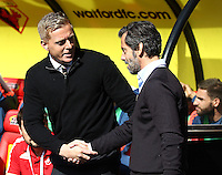 Garry Monk manager of Swansea shakes hands with Quique Flores manager of Watford   during the Barclays Premier League match Watford and Swansea   played at Vicarage Road Stadium , Watford
