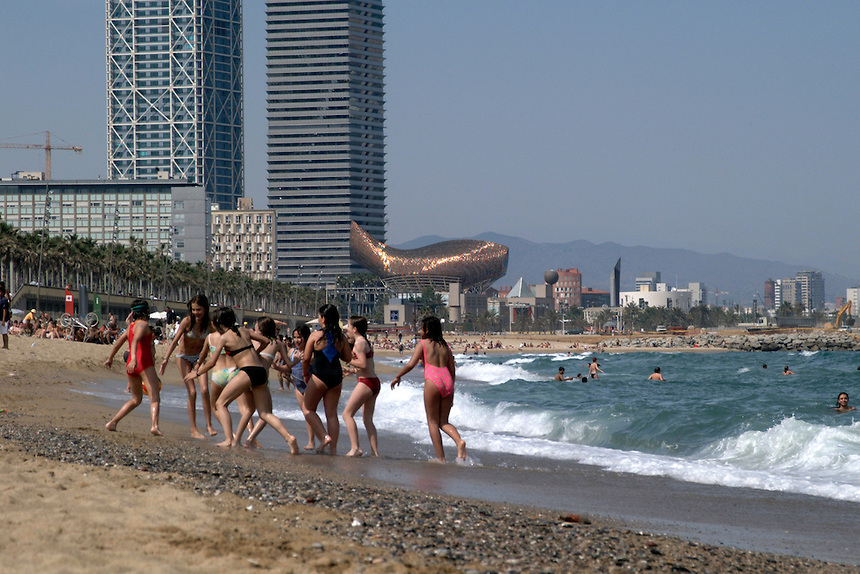 Young girls playing on beach in Barcelona.