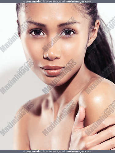 Natural beauty portrait of a young mixed race asian woman with an exotic look woman on white background