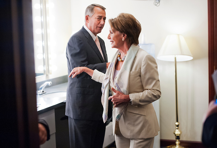 UNITED STATES - JULY 10: Speaker John Boehner, R-Ohio, and House Minority Leader Nancy Pelosi, D-Calif., run into each other in the green room in between their weekly news conferences in the Capitol Visitor Center's Studio A, July 10, 2014. (Photo By Tom Williams/CQ Roll Call)