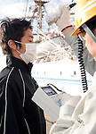 A member of the so-called Fukushima 50 is given a radiation check prior to boarding the Kaiwomaru in the dock at Onahama Port, Iwaki City, Fukushima Prefecture on  23 March 20011.  .Photographer: Robert Gilhooly