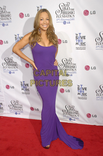 MARIAH CAREY.VH1 Save the Music Foundation celebrates its first decade of success with a 10th anniversary gala presented by LG Mobile Phones at Lincoln Center, New York, New York, USA,  20 September 2007..full length purple dress hand on hip.CAP/ADM/BL.©Bill Lyons/AdMedia/Capital Pictures. *** Local Caption ***