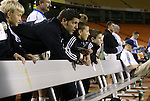 30 October 2004: Regular Wizards' starting goalkeeper Tony Meola (center) who was slated to start, instead watches warmups with some young fans after reaggravating an ankle injury. The Kansas City Wizards defeated the San Jose Earthquakes 3-0 at Arrowhead Stadium in Kansas City, MO in the second leg of their Major League Soccer Western Conference Semifinal playoff series. The Wizards eliminated the Earthquakes 3-2 on aggregate goals..