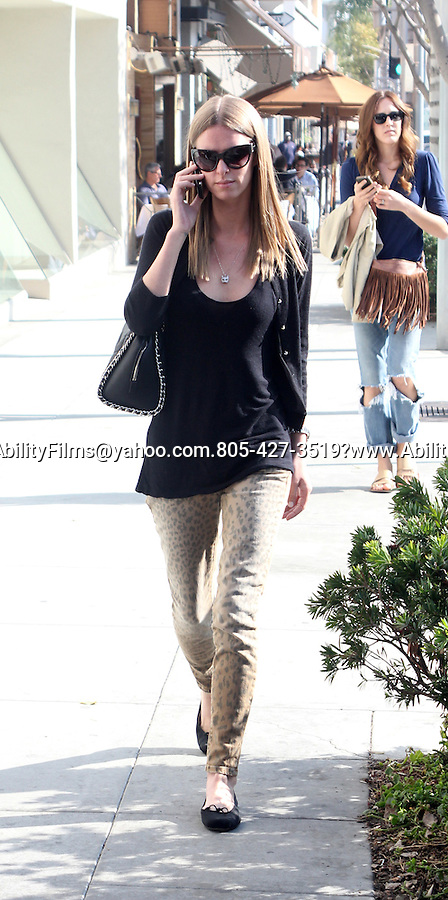 February 2nd  2012   ...Nicky Hilton carrying a  black Chanel  purse & leopard cheetah pants cat necklace walking in Beverly Hills CAlifornia...AbilityFilms@yahoo.com.805-427-3519