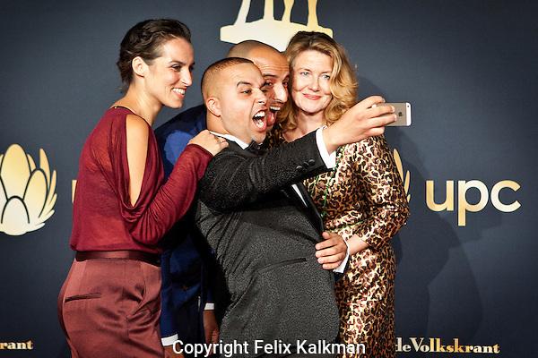 Utrecht, 27 september 2014<br /> Nederlands FIlm Festival<br /> Premiere Infiltrant: Rachid el Ghazaoui maakt een selfie op de rode loper.<br /> Vlnr: Nadia Amin, Rachid el Ghazaoui, Walid Benmbarek, Betty Schuurman.<br /> Photo by Felix Kalkman
