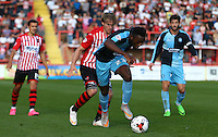 Gozie Ugwu of Wycombe Wanderers under pressure from Christian Ribeiro of Exeter City during the Sky Bet League 2 match between Exeter City and Wycombe Wanderers at St James' Park, Exeter, England on 26 September 2015. Photo by Pinnacle Photo Agency.
