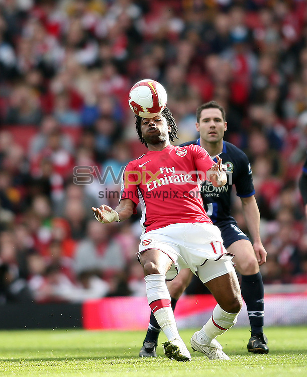 PICTURE BY JEREMY RATA/SWPIX.COM. Barclays Premier League 2008/9 - Arsenal v Blackburn Rovers, Emirates Stadium, London, England. 14th March 2009. Arsenal's Alex Song fields the ball on his chest as Blackburn's David Dunn looks on..Copyright - Simon Wilkinson - 07811267706